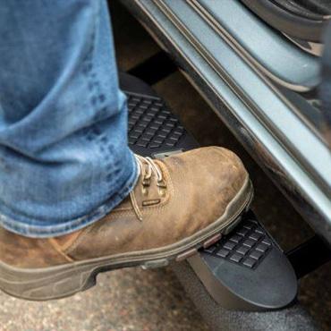 A man feet going up a truck